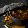 In use the beautiful Chasseur 24cm Cast Iron Enamel Casserole Dish & Lid 3.8L - Urban Grey